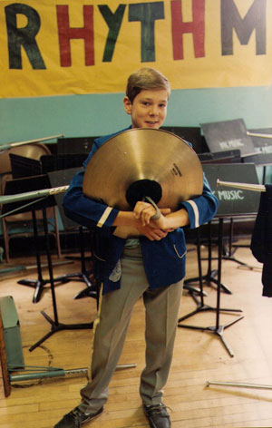 Willie played cymbals in the middle-school marching band.